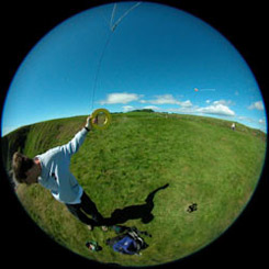 Photo of me hanging onto the kite as I launch the camera